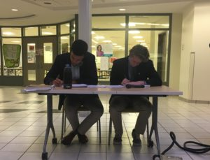 Max Lee and Cameron Luther study their notes during the final debate